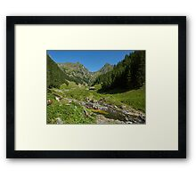 Wooden house in a mountain landscape Framed Print
