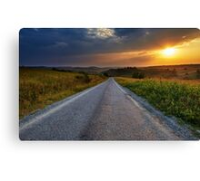 Road through corn fields at sunset Canvas Print