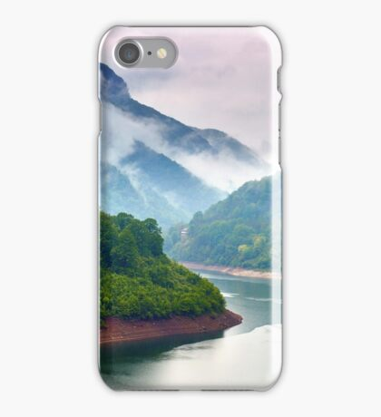 Lake in the mountains on a foggy day iPhone Case/Skin
