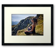 Woman practicing yoga on mountain Framed Print