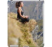 Woman practicing yoga on mountain iPad Case/Skin