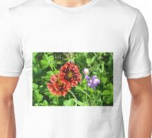 Beautiful colorful red flowers in the garden. Unisex T-Shirt