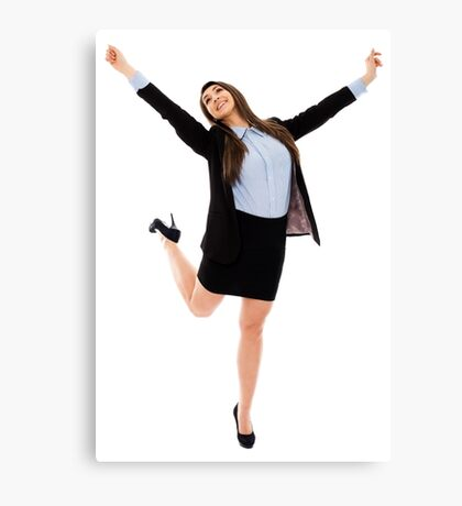 Successful businesswoman with arms raised Canvas Print