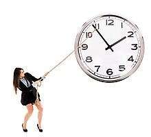 Businesswoman trying to stop time Photographic Print