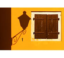 Street lamp shadow on a yellow wall. Photographic Print