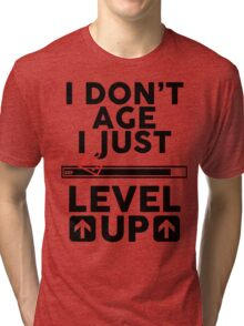 I don't age i just level up Tri-blend T-Shirt