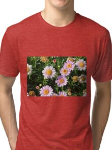 Beautiful light pink flowers natural background. Tri-blend T-Shirt