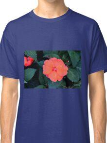 Orange flowers between green leaves. Classic T-Shirt