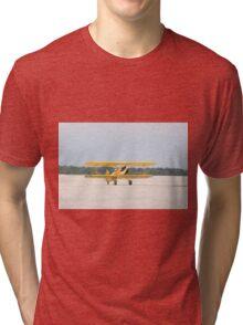 Single Engine Trainer Boeing Stearman PT-27 Kadet returning from flight. Tri-blend T-Shirt