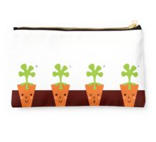 Sweet Carrots growing in dark Soil Studio Pouch