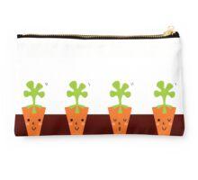 Sweet Carrots growing in dark Soil Studio Pouch