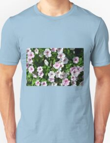 Pink flowers bush in the garden. Unisex T-Shirt