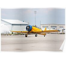 Single engine trainer North American Harvard IV rolling to location for stop. Poster