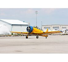 Single engine trainer North American Harvard IV rolling to location for stop. Photographic Print