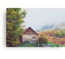 Mountains in autumn. Abandoned warehouse in highlands. Canvas Print