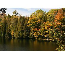 Tress  in Fall colours around the lake and their reflection in the water.  Photographic Print
