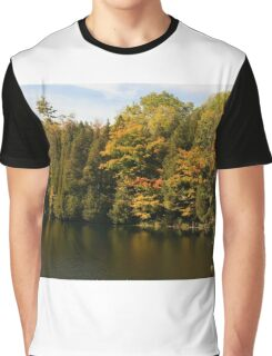 Tress  in Fall colours around the lake and their reflection in the water.  Graphic T-Shirt