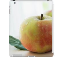 apples with green leaves on wooden table iPad Case/Skin