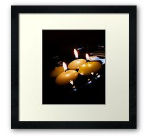 Candles in the water Framed Print