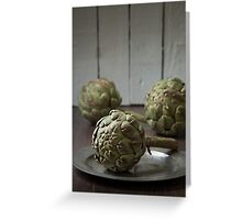 Artichokes in a rustic kitchen Greeting Card