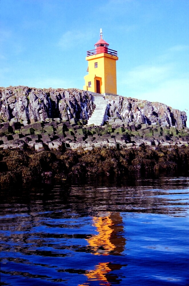 Lighthouse on small island near Flatey  by Carole-Anne