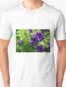 Dark purple flowers natural background. Unisex T-Shirt