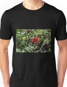 Red flowers in the green grass. Unisex T-Shirt