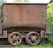 Rusty coppermine carriage by Arie Koene