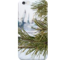 Branch of a pine on blurred background industrial landscape iPhone Case/Skin