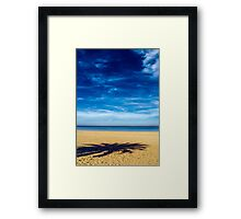 Solitude on empty beach Framed Print