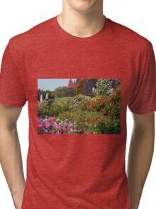 Beautiful colorful park with many flower arrangements. Tri-blend T-Shirt