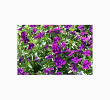 Beautiful purple flowers in the garden. Natural background. Unisex T-Shirt