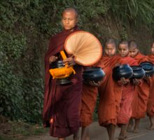Buddhist Monks with bowls collect food donation for their meal Sticker