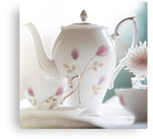Hand painted china teapot, cup and saucer, with a flower. Canvas Print