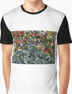 Natural background with small red flowers among green leaves. Graphic T-Shirt
