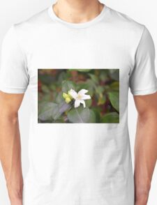 Small white flower and green leaves. T-Shirt