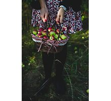 woman carrying a basket of apples Photographic Print