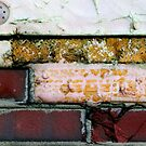 yellow red brick wall by richman