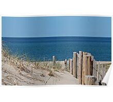 Sandy beach and deep blue sea Poster