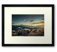 Wispy clouds over mountains Framed Print