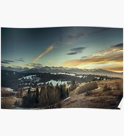 Wispy clouds over mountains Poster