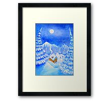 A little house in the snow Framed Print