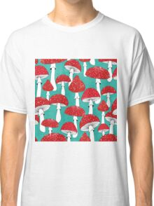 Red mushrooms on turquoise blue Classic T-Shirt