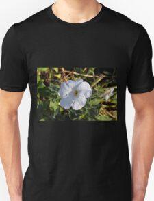 White flower in the grass. Unisex T-Shirt