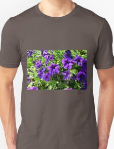 Purple flowers and green leaves natural background. T-Shirt