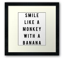 Smile like a monkey with a banana Framed Print