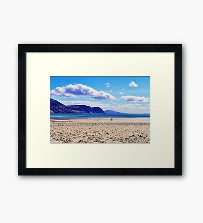 Wandering on the beach under the clouds Framed Print