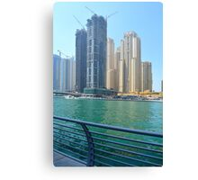 Photography of many tall buildings, skyscrapers skyline seen from the water from Dubai. United Arab Emirates. Canvas Print