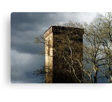 Old medieval church tower on dark stormy sky background, Teruttenhousen abbey Canvas Print