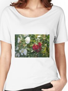 Red and white flowers in the park. Natural background. Women's Relaxed Fit T-Shirt